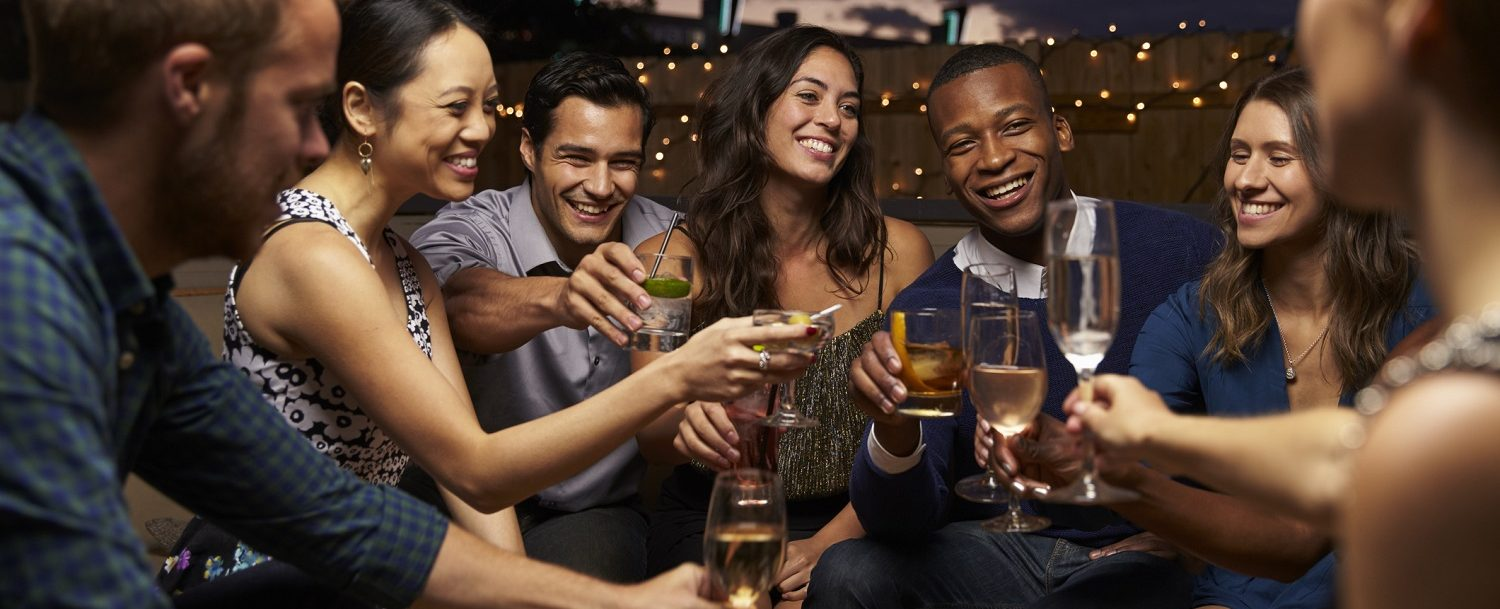 Group of friends having drinks at one of the best Savannah nightlife attractions