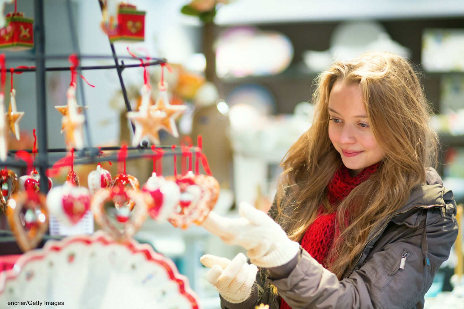 Girl admiring ornaments while enjoying Christmas in Savannah, GA