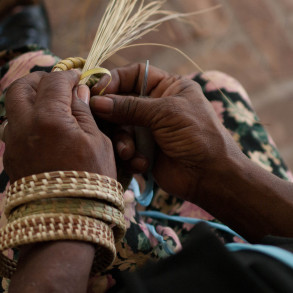 Woman sewing a sweetgrass basket on the Gullah Islands