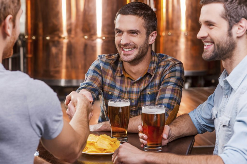 Group of friends hanging out at breweries in Savannah, GA