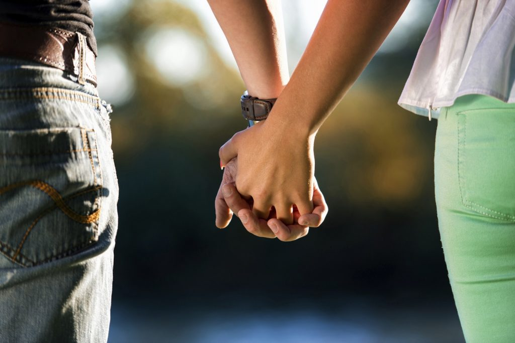 Couple holding hands on Valentine's getaways