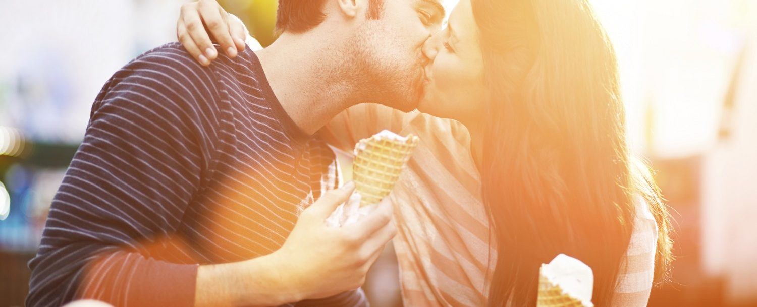 Couple eating ice cream on romantic getaways