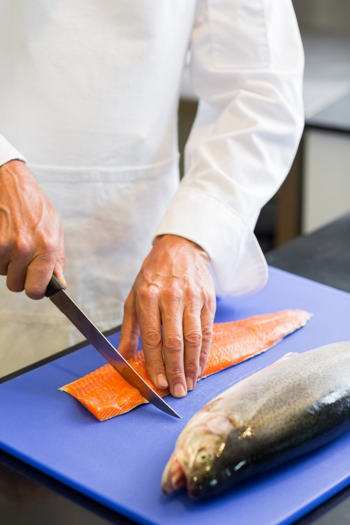 Chef cutting fish at the Savannah Seafood Festival