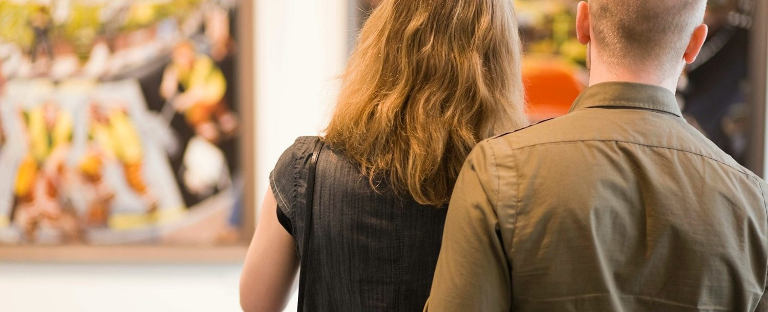 Couple looking at a painting at the Telfair Museums