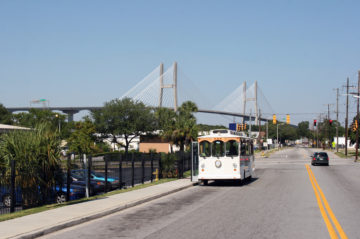 Savannah trolley in front of the Talmadge Bridge
