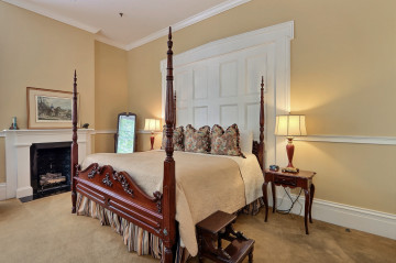 View of the bed in the James Monroe room - Day Trips From Savannah to Charleston